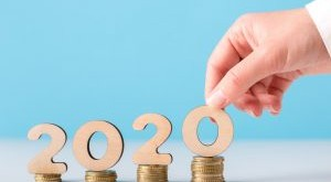 man-hand-with-2020-concept-on-coins-ascending-JDR7ZT2-300x184.jpg