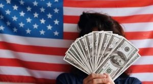american-flag-and-money-nominated-WLRHRQT-300x200.jpg