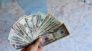 dollars-in-the-hands-dollar-bills-cash-us-currency-money-map-in-the-backgraund-tourism-concept-dollar_t20_8dydgg-300x200.jpg