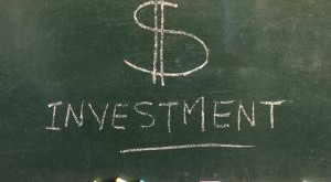 investment-written-in-chalk-on-a-chalkboard-creative-concept-banking-and-finance_t20_NxQKZQ-300x225.jpg