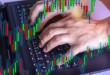 double-exposure-of-stock-market-graph-with-man-working-on-laptop-on-background-concept-of-financial_t20_omylQe-1024x684.jpg
